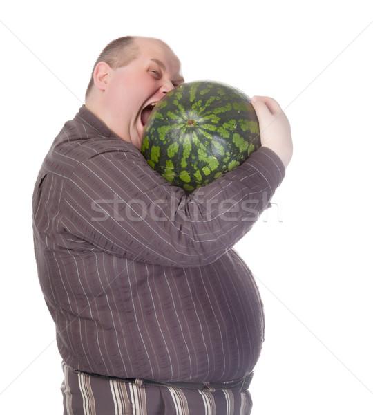 Fettleibig Mann beißen Wassermelone riesige Bauch Stock foto © Discovod
