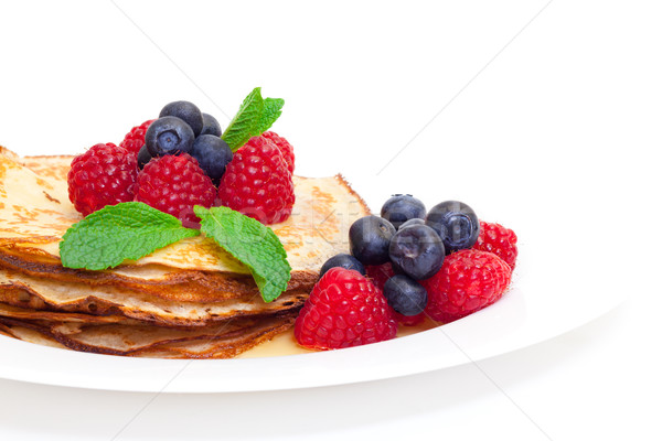 Delicious Freshly Prepared Pancakes with Honey and Berries Stock photo © Discovod