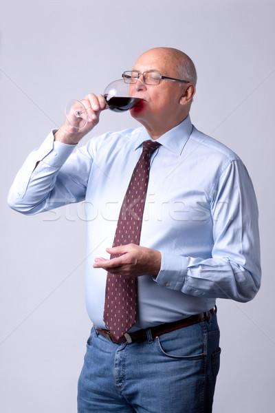 portrait of a successful senior man with glass of wine Stock photo © Discovod