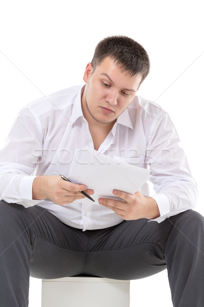 Businessman reading a report with scepticism Stock photo © Discovod