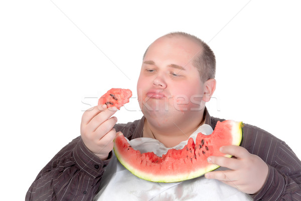 Fat man savouring a slice of watermelon Stock photo © Discovod