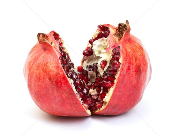 Quebrado romã fruto branco comida vermelho Foto stock © Discovod