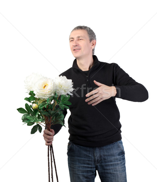 Man holding a bouquet of flowers Stock photo © Discovod