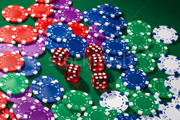 Colorful poker chips and red dice Stock photo © Discovod