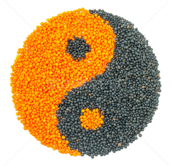 Orange and Black Lentil forming a yin yang symbol Stock photo © Discovod