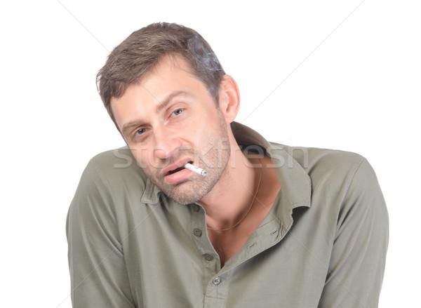Hombre guapo fumar aislado blanco humo retrato Foto stock © Discovod