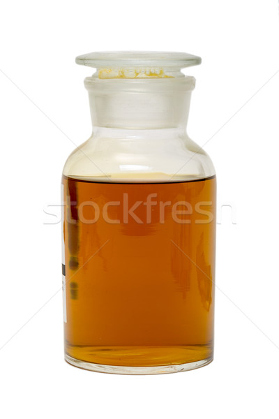 Large Glass Jar with a Lid, Filled with Dark Yellow Honey Stock photo © Discovod