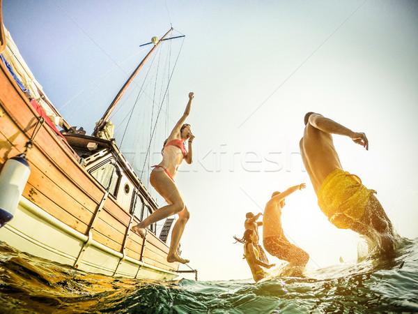 молодые богатых люди дайвинг парусного лодка Сток-фото © DisobeyArt