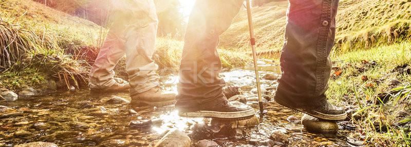 Couple randonneurs trekking Suisse montagnes été Photo stock © DisobeyArt
