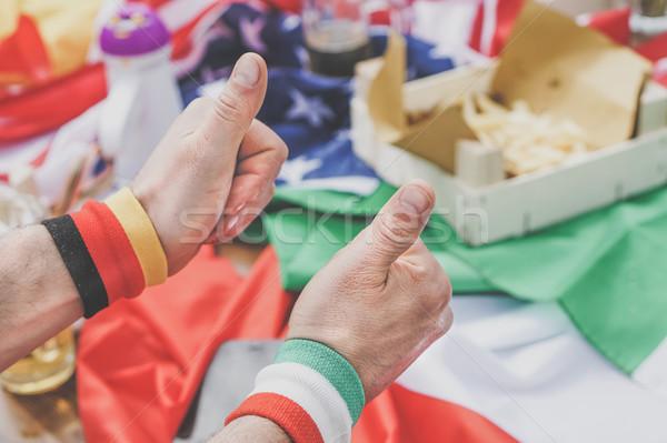 Grup futbol fanlar kutlamak destek takım Stok fotoğraf © DisobeyArt