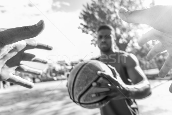 Multiracial basket players challenging in one to one  game in ur Stock photo © DisobeyArt