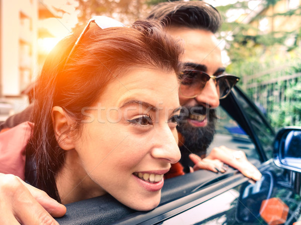 Hipster couple looking outside from their cabrio having fun toge Stock photo © DisobeyArt