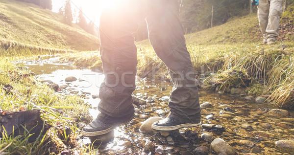 Trekkers doing excursion in swiss alps mountain at sunrise - Hik Stock photo © DisobeyArt