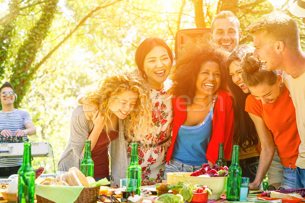 Group of young people having barbecue dinner party with dj in pa Stock photo © DisobeyArt