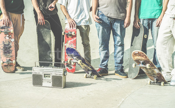 Young friends holding skateboards in hands outdoor on city skate Stock photo © DisobeyArt