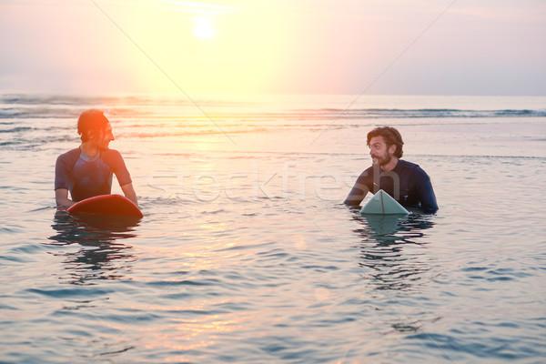 Két férfi szörfdeszka napos idő bent víz tengerpart Stock fotó © DisobeyArt