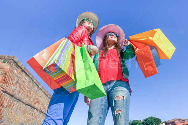Young beautiful women sharing free time having fun and shopping  Stock photo © DisobeyArt