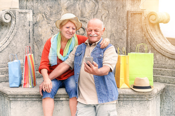 Senior couple taking selfie after shopping with smartphone - Hap Stock photo © DisobeyArt