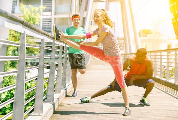 Grup arkadaşlar jogging köprü dışarı Stok fotoğraf © DisobeyArt