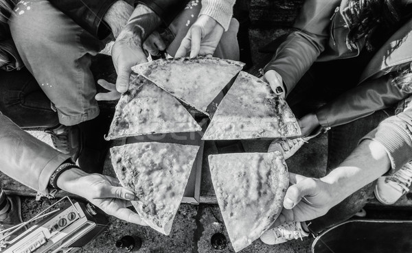 Group of hipster friends toasting pizza take away on staircase c Stock photo © DisobeyArt