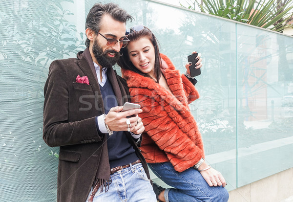 Happy couple using mobile phone for shopping online - Fashion pe Stock photo © DisobeyArt