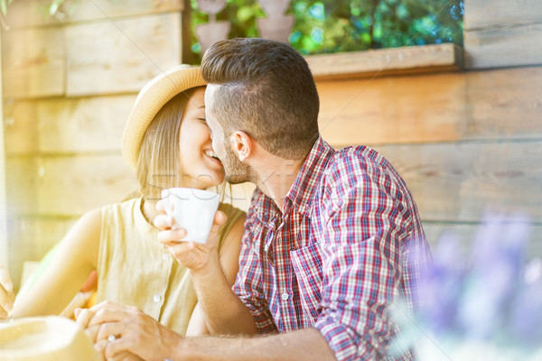 Couple of young lovers kissing at cafe bar restaurant - Two hand Stock photo © DisobeyArt