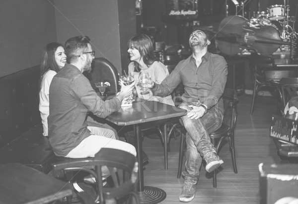 Stock photo: Happy friends cheering at cocktail jazz bar - Young trendy peopl