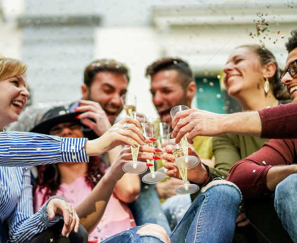 Stock photo: Happy friends cheering with champagne and making party outdoor -
