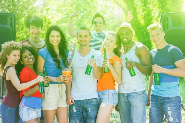Groep vrolijk mensen zomer partij Stockfoto © DisobeyArt