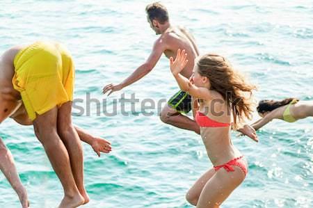 Boldog barátok készít úszómedence buli üdülőhely Stock fotó © DisobeyArt