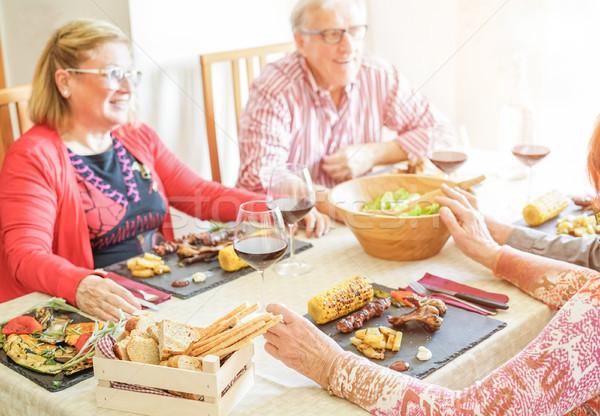 Senior felice amici pranzo pasto Foto d'archivio © DisobeyArt