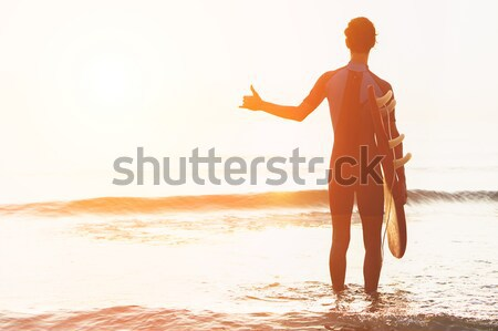 Stock photo: Couple in love having romantic tender moments at sunset on the b