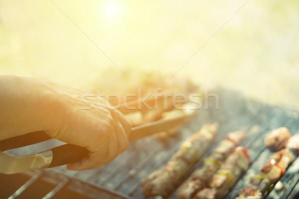 Fiatalember főzés hús barbecue szakács grill Stock fotó © DisobeyArt
