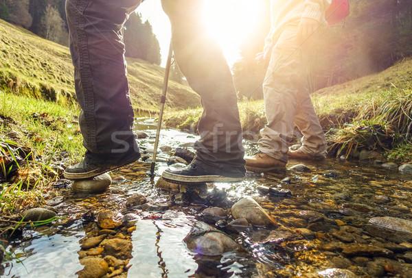 Two friends doing trekking in switzerland mountains in summer ti Stock photo © DisobeyArt