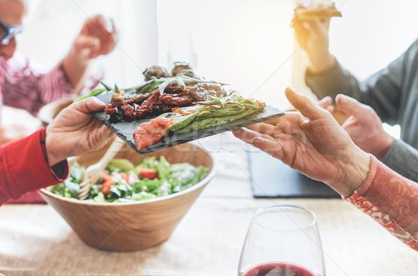Senior people having italian vegan vegetarian lunch at home - Ma Stock photo © DisobeyArt