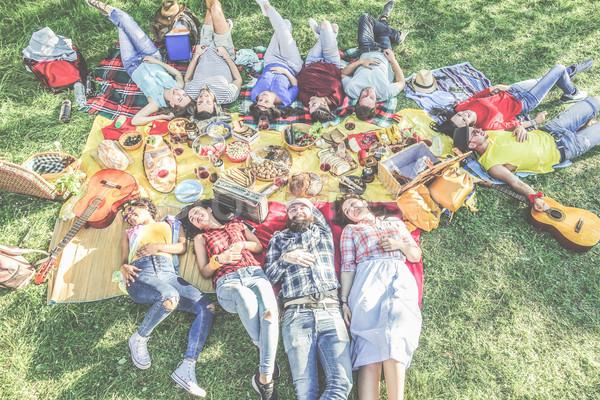 Boldog barátok fekszik piknik barbecue város Stock fotó © DisobeyArt