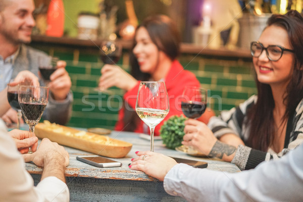 Happy friends drinking appetizer in trendy vintage winery bar -  Stock photo © DisobeyArt