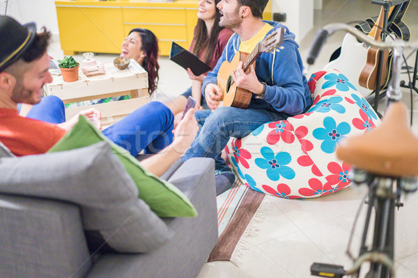 Group of trendy friends having fun in hostel living room - Happy Stock photo © DisobeyArt