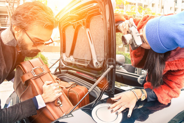 Stock photo: Hipster fashion couple having fun at loading leather travel suit