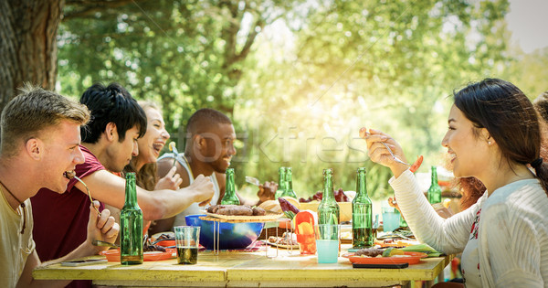 Stock photo: Happy students having barbecue on summer day in backyard home ga