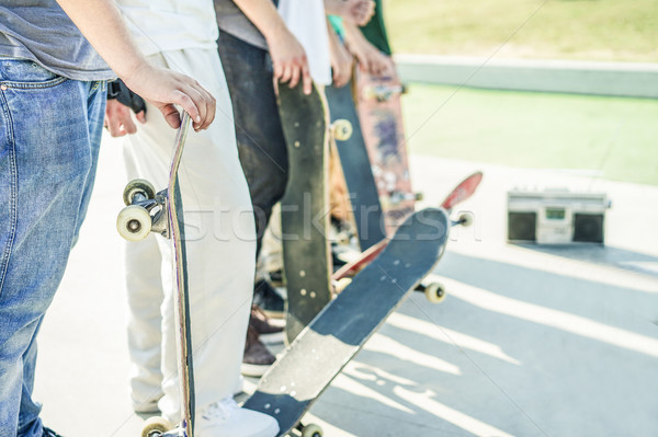 Stock photo: Group of skaters friends in urban contest with skateboards in th