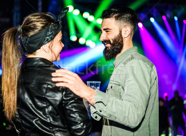Bearded man flirting with trendy woman inside night club - Hipst Stock photo © DisobeyArt
