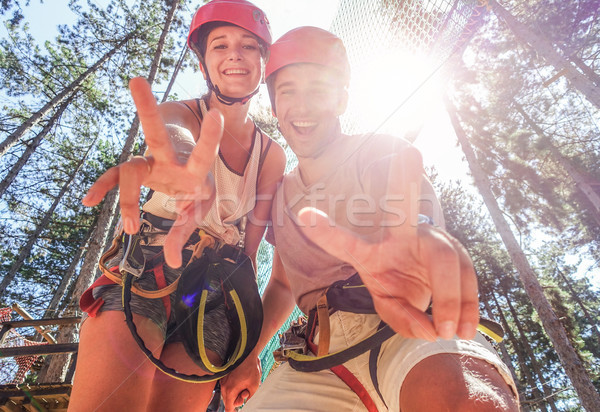 Couple of happy climbers having fun in adventure park outdoor -  Stock photo © DisobeyArt