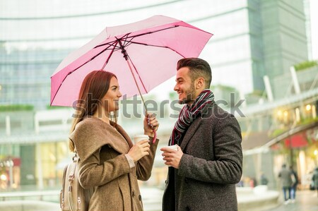 Happy romantic couple with coffee take away paper cup under a um Stock photo © DisobeyArt