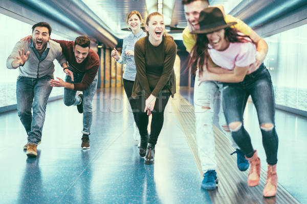 Happy friends having fun in underground metropolitan station - Y Stock photo © DisobeyArt