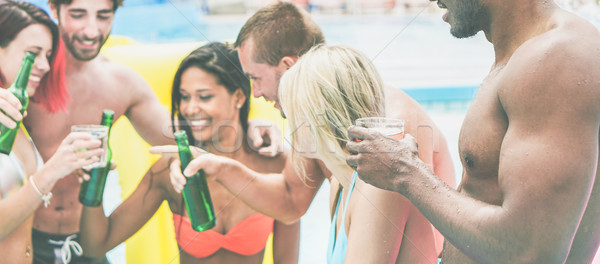 Group of diverse culture friends making pool party cheering with Stock photo © DisobeyArt