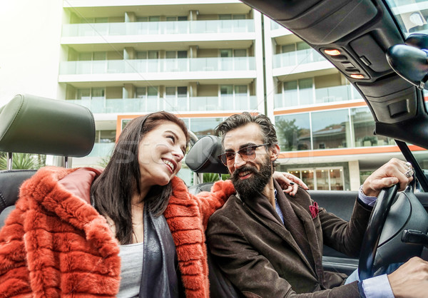 Hipster happy couple smiling inside cabriolet car during busines Stock photo © DisobeyArt