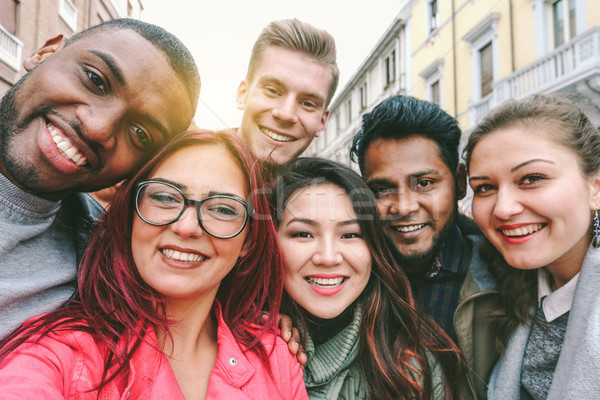 Happy friends from diverse cultures and races taking selfie with Stock photo © DisobeyArt
