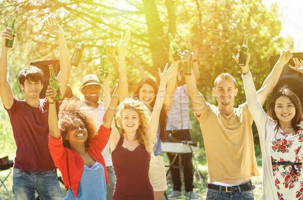 Genç arkadaşlar dans garden parti diskcokey Stok fotoğraf © DisobeyArt