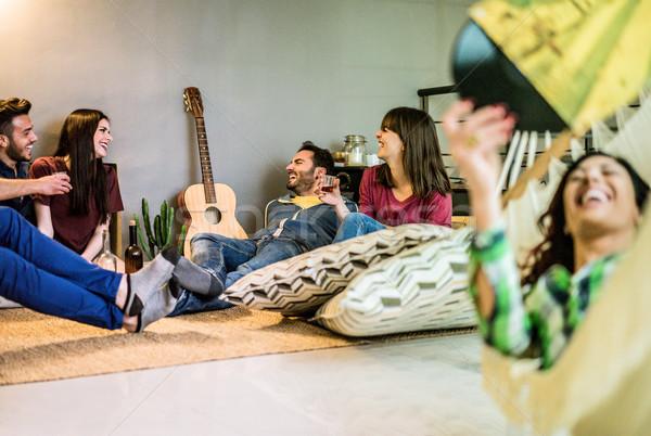 Boldog barátok buli otthon hallgat klasszikus Stock fotó © DisobeyArt